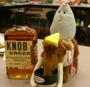Chicken, totally drunk riding Kay the Woollie Mammoth while she drinks out of his glass