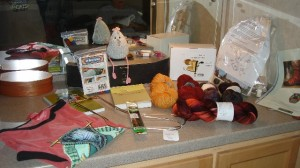 Gorgeous yarn, tools and souvenirs, a good mix.